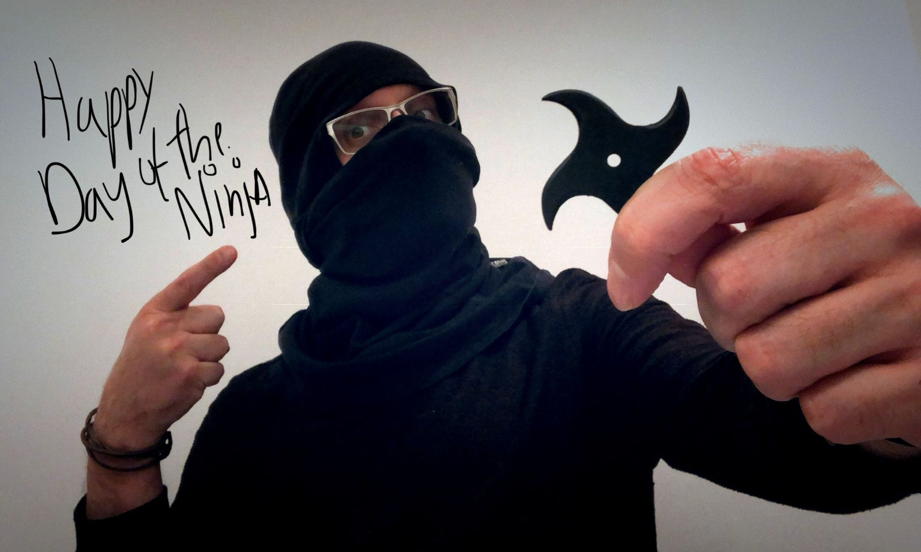 An authentic Ninja holding a Ninja star