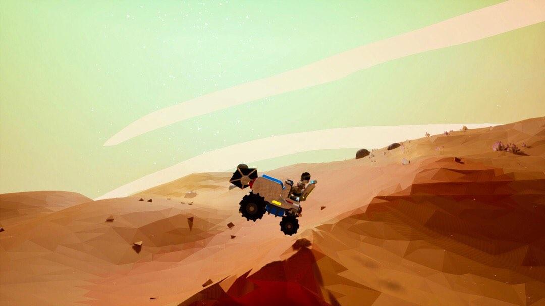 Ein Traktor, der über eine Düne springt.