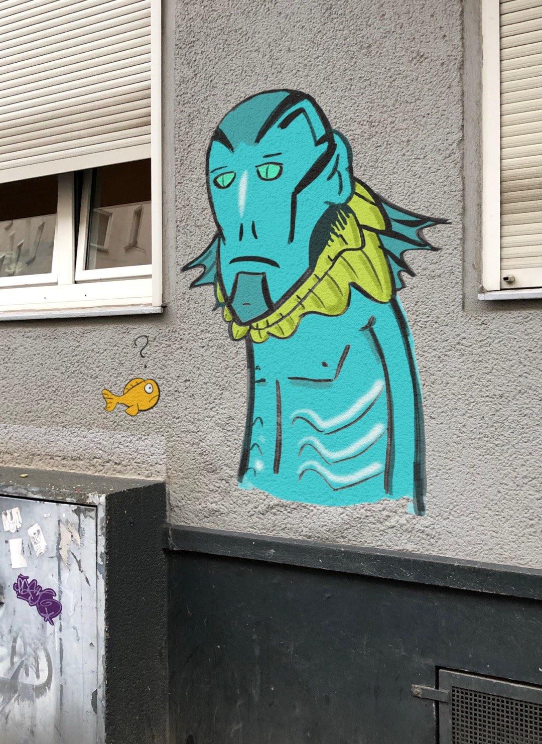 Digitale Abe Sapien Street Art auf einem Hauswandfoto.
